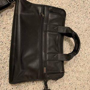 Tumi briefcase in a Napa black leather finish.